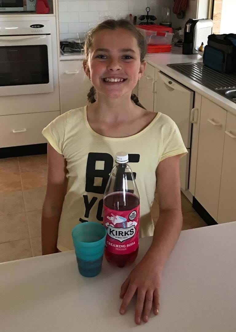 Community fundraiser Emily gave up soft drink for kids with cancer