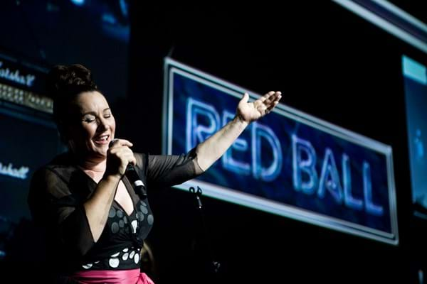 Grace Knight performs at Fight Cancer Foundation's Red Ball Melbourne in 2009.