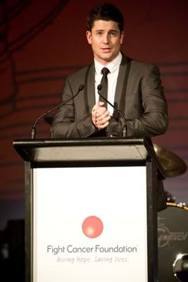Paul O'Brien on stage at Fight Cancer Foundation's Red Ball Melbourne in 2010