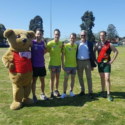 Bo Bear and Eric Wright with the team captains and match referees